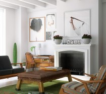 Mid-century modern furnishings and large-format modern photographs give this loft living room a balanced retro and modern feel.