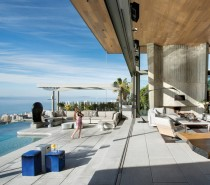 The west facing pool is oriented with expansive views of the vivid blue waters of the sea below.