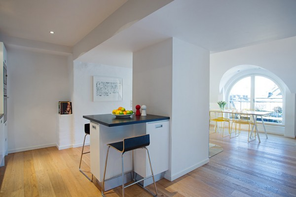 The eat-in kitchen offers an intimate space to eat breakfast or chat over a cup of coffee. The stark black and white decor is warmed by honey-toned floors.
