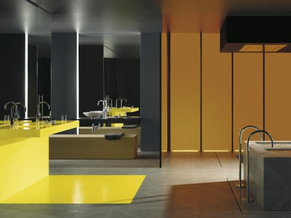 Brilliant yellow at the double sink vanity and floor below adds brilliant color and warmth to this bathrooms concrete floor and twin soaking tubs.