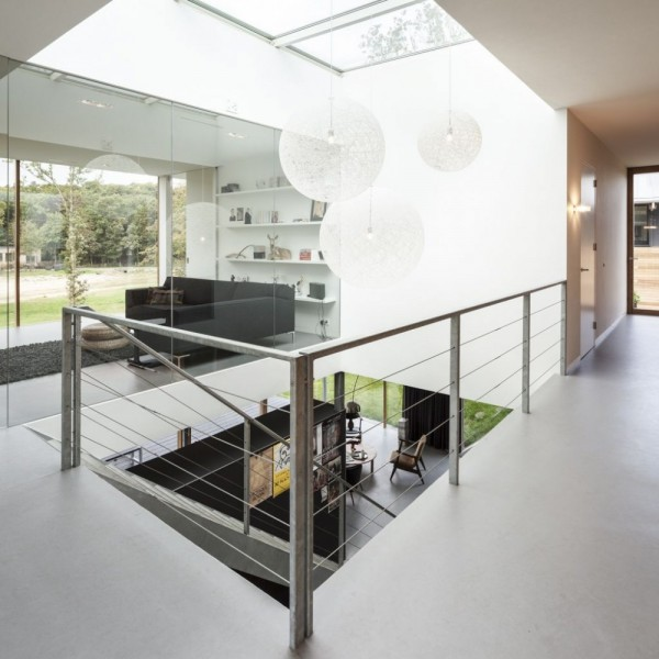 The villa's stairwell is at its center with a large skylight flooding light down through the levels.
