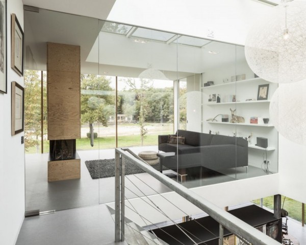 Glass walls in the villa's interior allow light to flow through the rooms from one side to another.