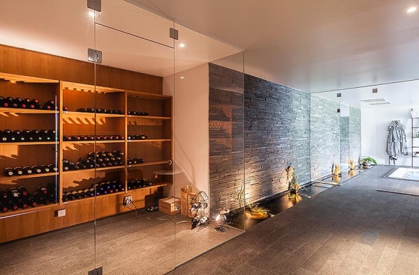 A wine lover's dream, this winde room doesn't hide the wine away in a musty cellar but puts it on display in a glass enclosed room.