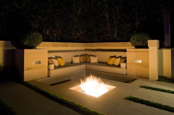 Fire pits such as this one are an essential of any outdoor living area. This one boasts an in-ground design surrounded by built-in seating.