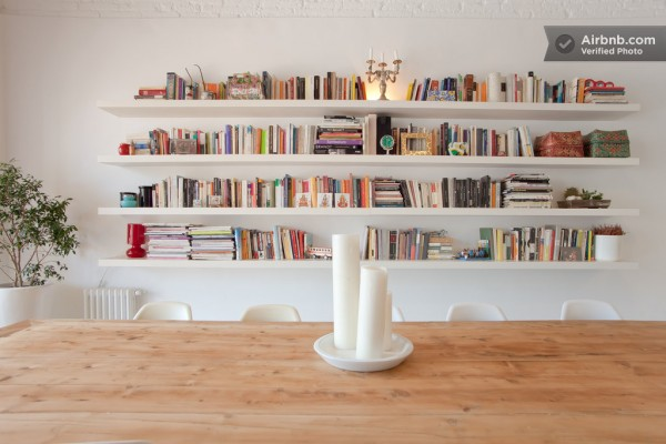 Bookshelves span the wall in the dining area creating a library feel.