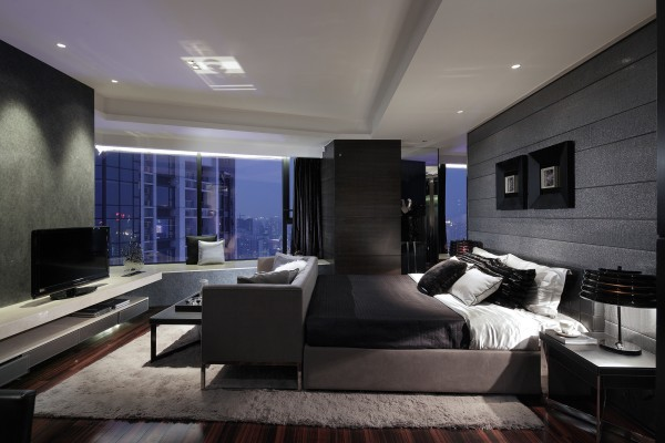 A common element in all of Leung's bedroom designs is atmospheric lighting. Here he illuminates the bed and media center display with recessed spotlights.