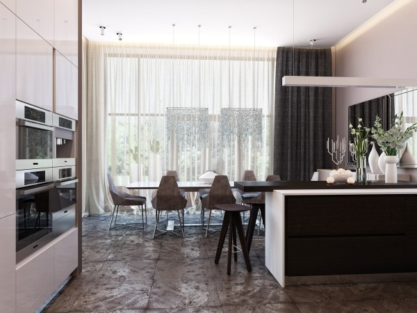 This view from the kitchen shows the size of the large open space through to the dining room. Twin waterfall lights add interest whole the rough stone floor tiles amp up the texture in the space.