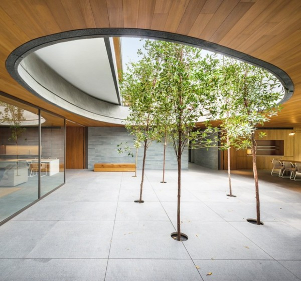 The huge central courtyard features an open air oculus and six willow trees for a minimalist look.