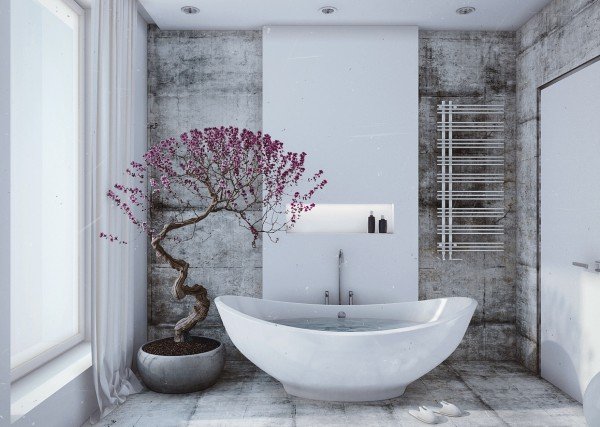 In the bathroom, it's all about creating a space that's peaceful. The soft grays and clean white that is seen throughout the apartment continues into the space, but minimalist furnishings and an interesting botanical turn this room into a work of art. The curve of the tub, use of smooth stone,and the pop of color from the tree invoke thoughts of a stone garden in Japan.