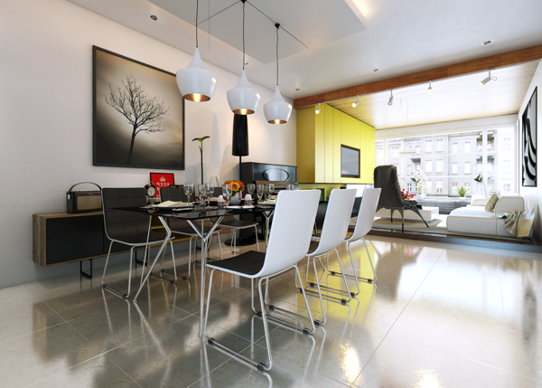 The high-shine concrete floor adds a dazzling visual element to the dining area as it bounces light off it and around the space.