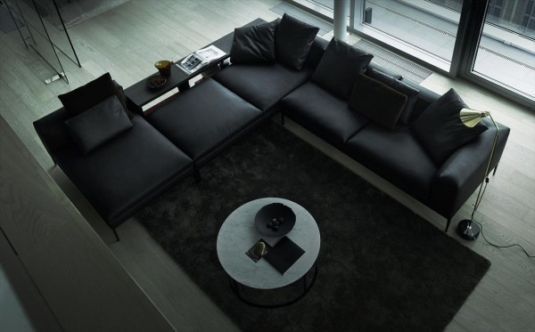 This sectional seating system consists of linear elements and hard lines. It is composed of five square and rectangular shaped ottomans with space for a console table.
