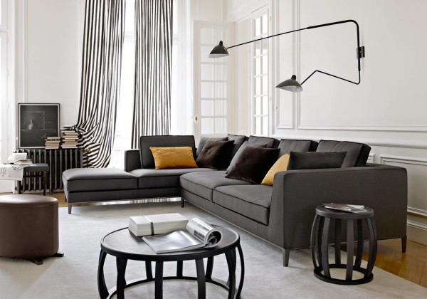 Comfort and style are accomplished in this living space with the linear sofa sectional and the abundance of accent pillows. The extra ottoman adds another option for putting your feet up after a hard day.