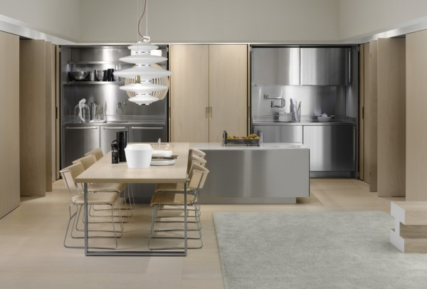 As the doors open, you can see a full stainless steel kitchen come into view.