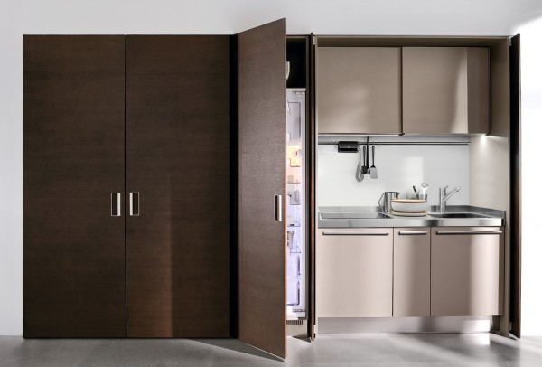 A refrigerator hides behind these recessed doors.