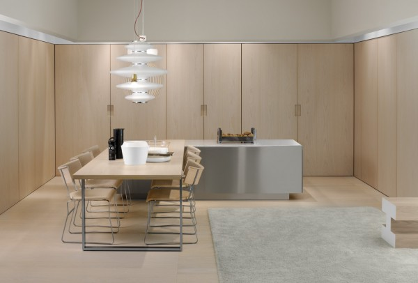 At first glance this appears to be simply a dining space, but the recessed doors hold much more.