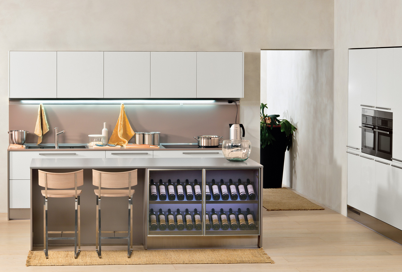 this classy kitchen space has a full wine rack built into the island it adds - Italian Kitchen Design Sinks