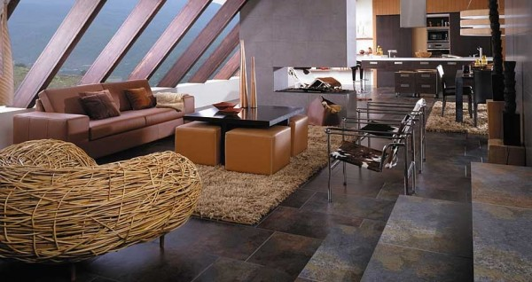These stone floor tiles reflect so many different colors and add personality to this living room. The tiles are relatively dark but with so many colors found within them, it doesn't make the room appear too dark.
