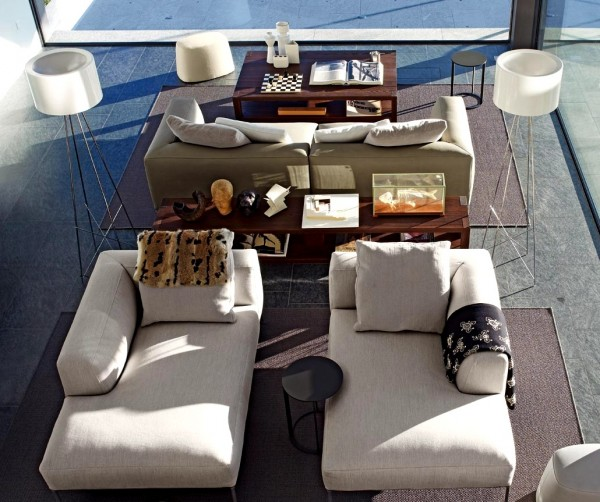 Two separate seating areas are created with these sectional sofa pieces that are used individually rather than as one unified piece. The wooden center console table connects yet separate the spaces.