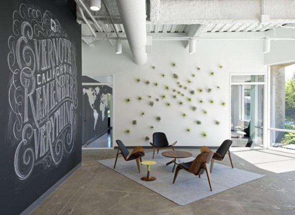 The large reception area is full of creativity with chalk artistry of the company's identity and a coffee and break bar built in Douglas fir.