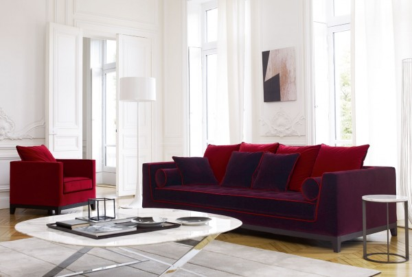 This design is for someone who is not afraid of color. The furnishings can be done in various colors, but in this space the jewel toned red and purple fabrics really jazz up a  monochromatic space.
