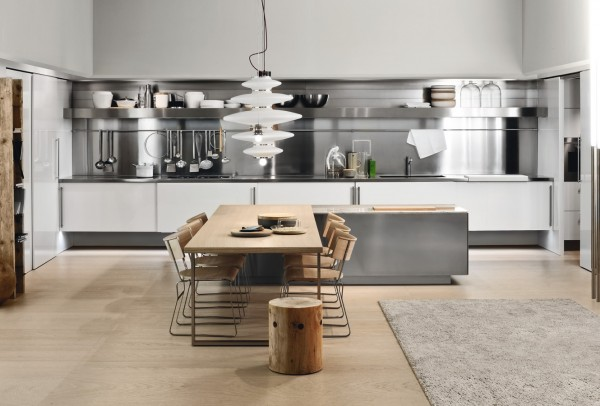 The fully functional kitchen is revealed when all the recessed doors are open, and now the space can be used as both a dining and preparation space.