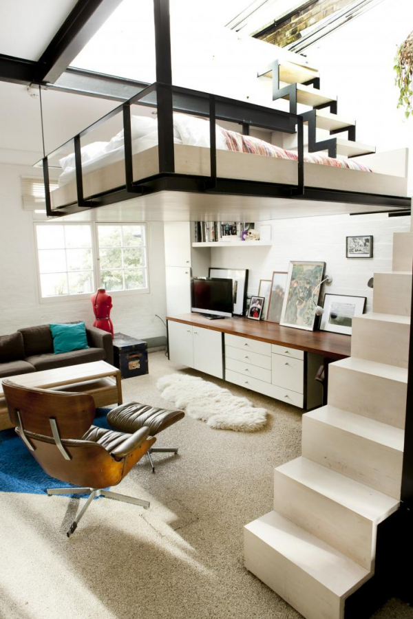 The first thing you notice in this combination living area is of course the bed suspended from the ceiling. Accessible by narrow staircase off to the side, this is really saving space because fitting a bedroom would have made for a closet sized living room. Not only does the bed conveniently suspend from the ceiling, but it is underneath a large, retractable glass panel that provides access to the rooftop terrace.