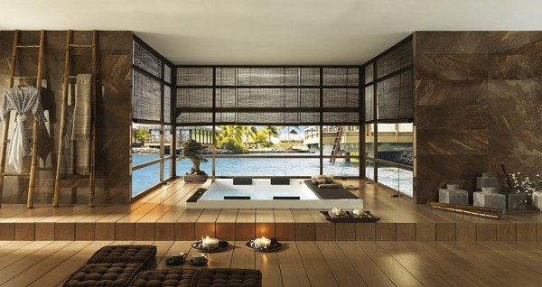 Another luxurious spa but this one is enclosed by glass walls that provide beautiful views, but can have shades drawn for privacy. The walls are stone tile and the flooring is a rich hardwood.