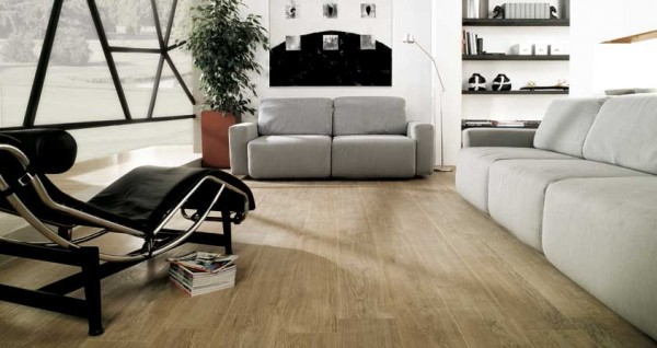 Beautiful wooden floors warm up this living room space.