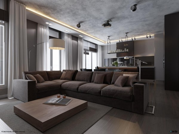 The plush living room sofa contrasts with the otherwise clean lines of most of the apartment while still staying true to the monochromatic theme. It is evidence of the designers unwillingness to sacrifice all comfort in the name of style.
