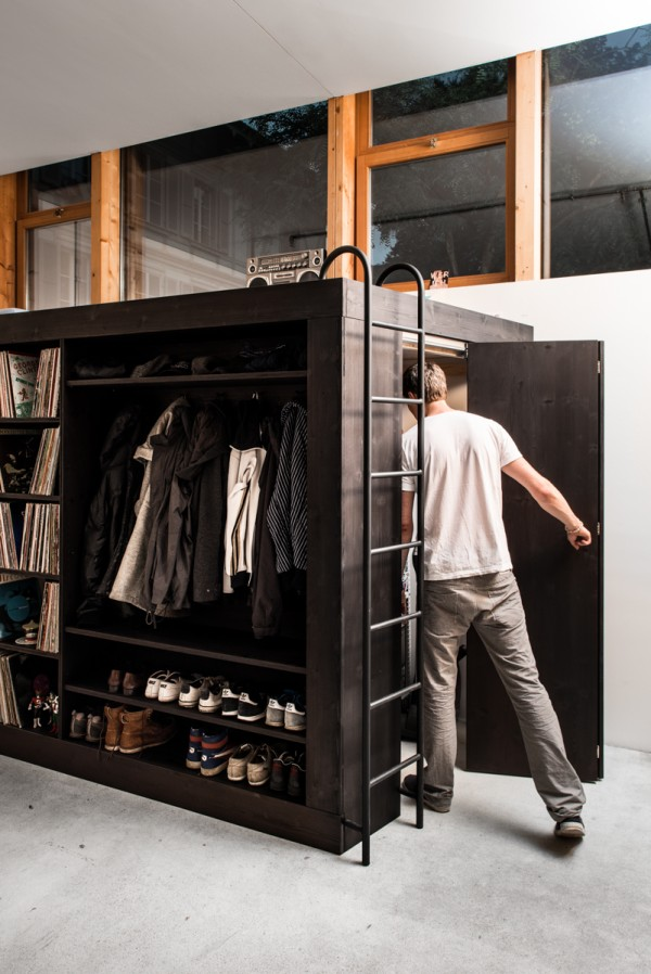 A small door on the side of the cube is just large enough for Könneker to walk though, giving him easy access to his clothes and other stored items inside.