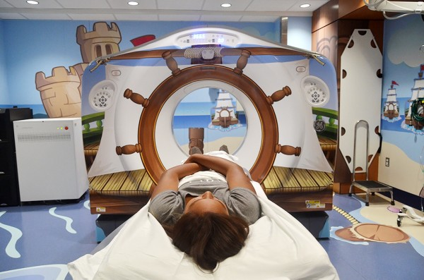 "The CT scanner is decorated like the ship's helm while playful animal pirates (notably, not ""scary pirates"" according to Dr. Carrie Ruzal-Shapiro, chief of Pediatric Radiology) swing from ropes around the room."