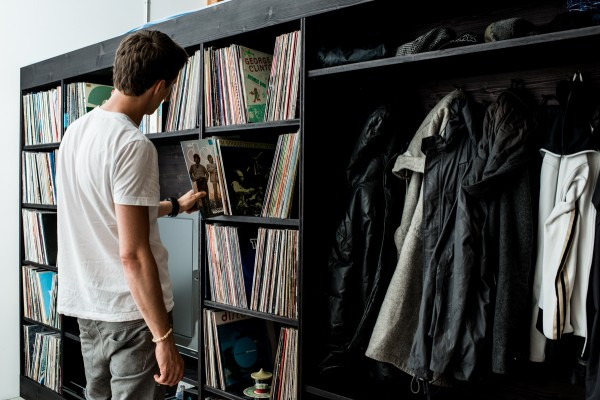 The shelves surrounding the television cubby are perfectly fit to vinyl records and even have space for adding to the already ample collection that is housed there.