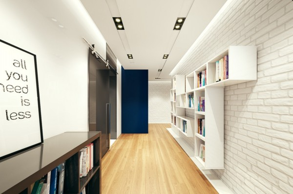 Rather than let bookcases sit on the floor, they are affixed to the white brick wall in a way that makes them seem to be floating. Placing them in the hallway means they don't clutter other valuable wall space and lets the books themselves add color to the design.
