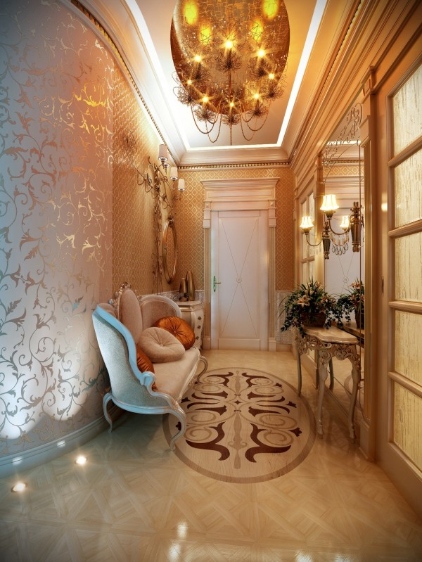 Even hallways can feel regal with the right trappings. Here, the use of a brocade wallpaper and mirrors make the space feel big and expensive, so no one could complain about waiting here for a few moments.
