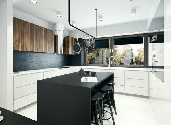 The kitchen has ample counter space on every edge and makes use of a center island, appropriate for both meal preparation and sitting down for a quick bite.