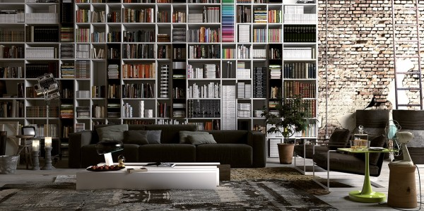 This urban industrial apartment has vaulted ceilings, but in most cases, that just means a lot of empty space above your head. The massive shelving unit takes full advantage of the extra area, letting you stack books all the way up to the top and including a ladder for quick, if precarious access to every level.
