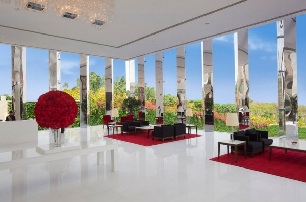 In this stark modern lobby, it would be easy to feel transported to any European city. Mirror columns and massive flower arrangements are the height of swank luxury.