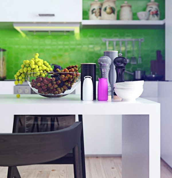 The kitchen is small but with its own vibrant elements. The eye is particularly drawn to the electric green backsplash, which stands out against an otherwise white room.