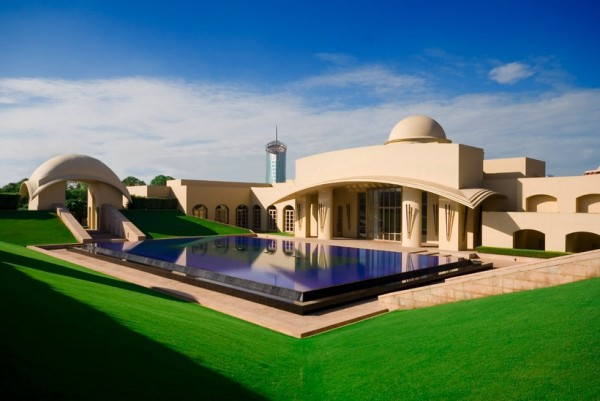 Not all Indian architecture is arched windows and Taj Majal. This geometric design combines modern elements with classic Indian style, making this particular pool feel more space age than colonial.