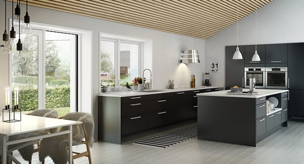 By using black and white as the color palette for this modern kitchen, the designers give it an instantly timeless feeling. An expansive island offers more surface area while appliances built into the wall keep the temperature reasonable, regardless of that old adage about heat and kitchens.