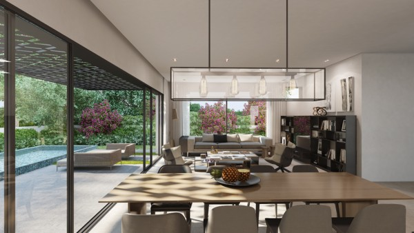 The main living area of this house utilizes an open floor plan with a gourmet kitchen opening out into a full dining room and living room. Large sliding glass doors can let in both sun and fresh air when the climate allows.