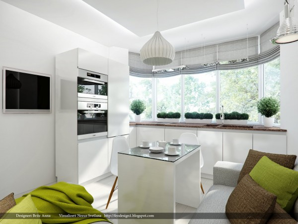 This modern kitchen makes use of a small floor space but does not skimp on counters. A center island could easily be used for storage, meal preparation, or as it is styled here as a comfortable breakfast area.