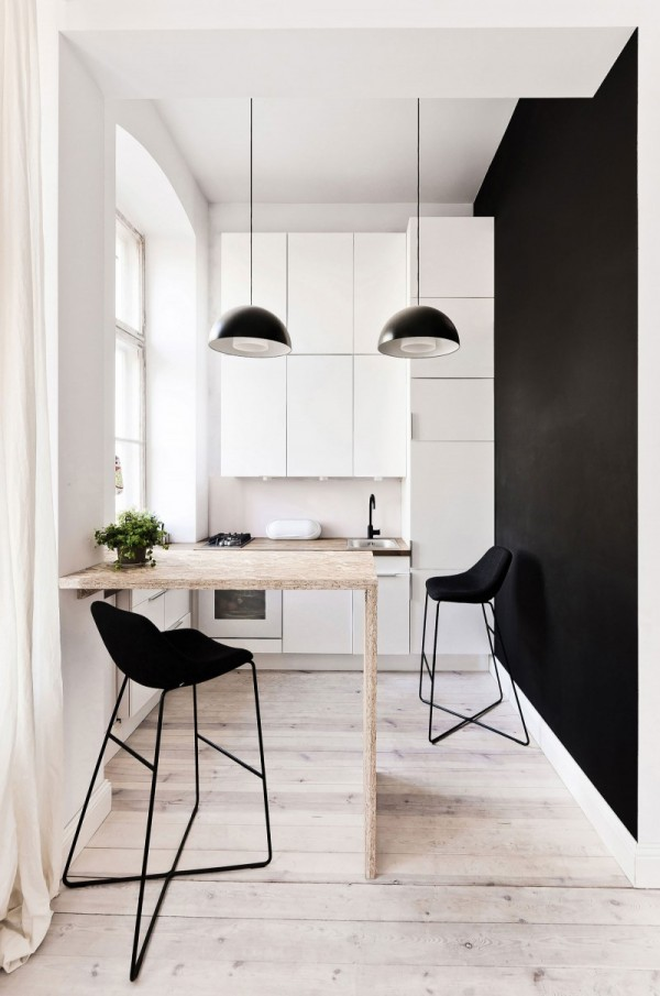 The small kitchen again makes use of the high ceilings with storage space going all the way up.