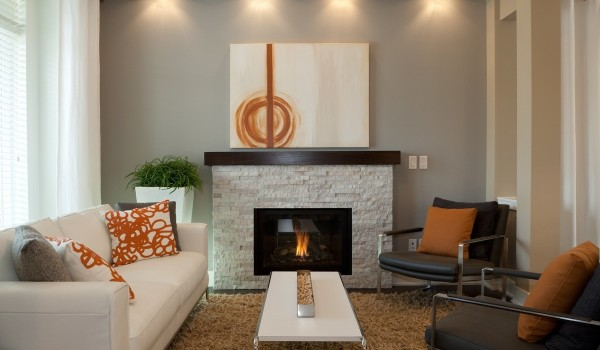 Straying away from the bright and feminine colors of some of the other rooms, the burnt orange accents here are much more neutral, but still add a certain pop that brings dimension to the interior.
