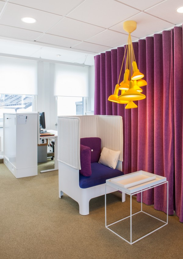 There are no proper offices in the new HSB space. Instead, cozy chair like this one provide privacy for those that prefer it. The orange light fixture overhead adds a playful spice to the area.