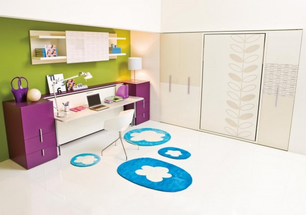 Cute blue rugs with cloud details given an cartoonish feeling to the room - in a good way.