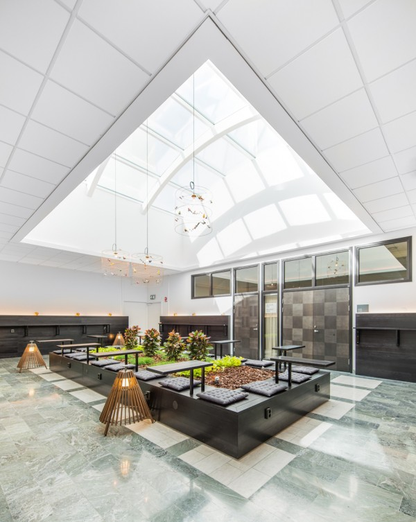 This central atrium is a beautiful gathering space for both work and relaxing. Sun streams in through the ceiling all day and the greenery nestled in the center can offer respite from chilly Stockholm winters.
