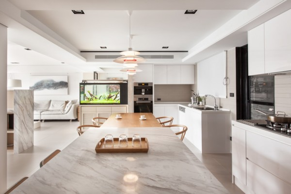 While the kitchen is typically a place that bursts of color find their home, this one has been kept a gleaming white from cabinetry to countertop.