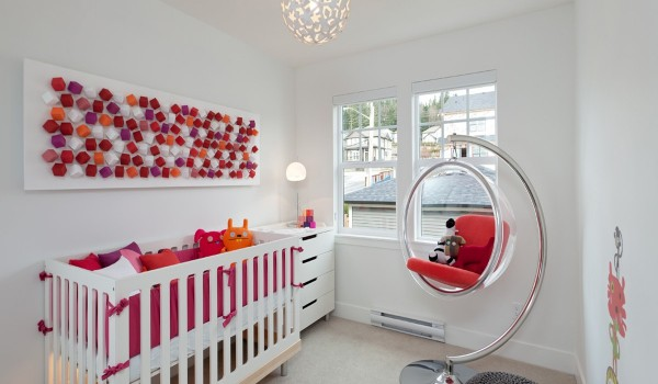 Having a new addition to the family does not have to mean sacrificing style. This nursery is modern but carefully accented with playful colors and different textures and materials to keep the attention of baby and parents alike.