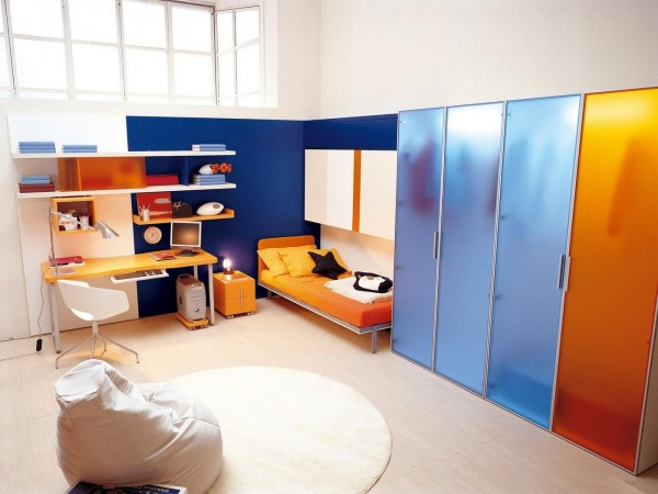 A tucked away bed, closet space galore and even a cozy bean bag chair make this a great boy's room.